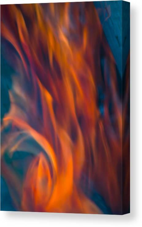 Hot Canvas Print featuring the photograph Orange Fire by Yulia Kazansky