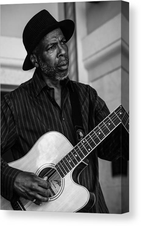 Black And White Canvas Print featuring the photograph Street Musician Black And White by Jon Cody
