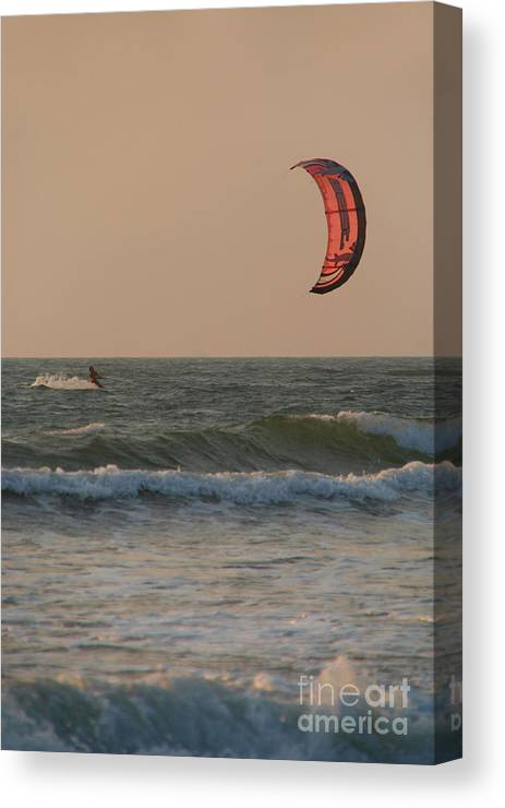 Kitesurfing Canvas Print featuring the photograph Kitesurfing At Sunset Mandrem by Serena Bowles