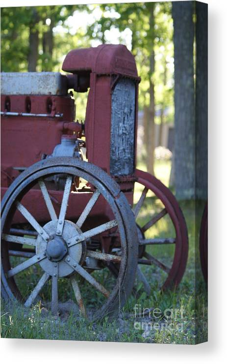 Vintage Canvas Print featuring the photograph Front End Of A Mccormic Deering Tractor by Rob Luzier