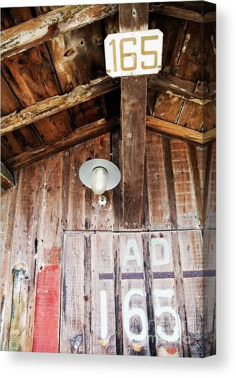 Aged Canvas Print featuring the photograph Light Hanging Inside An Old Wooden Hut by Sami Sarkis