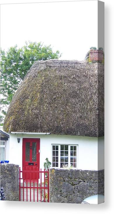Ireland Canvas Print featuring the photograph Thatched Roof Cottage With Red Door by Cathryn Brown
