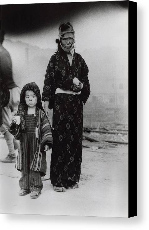 History Canvas Print featuring the photograph Nagasaki Atomic Bomb Survivors Holding by Everett