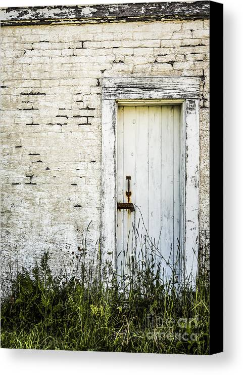Rustic Canvas Print featuring the photograph Weathered Door by Diane Diederich