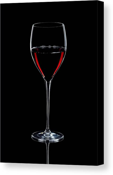 Wine Canvas Print featuring the photograph Wineglass Filled With Red Wine Silhouette by Alex Sukonkin