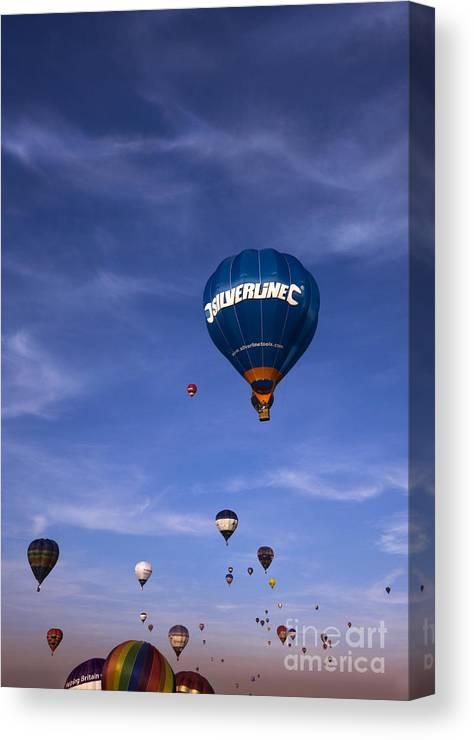 Balloon Fiesta Canvas Print featuring the photograph Blue Skies by Angel Ciesniarska