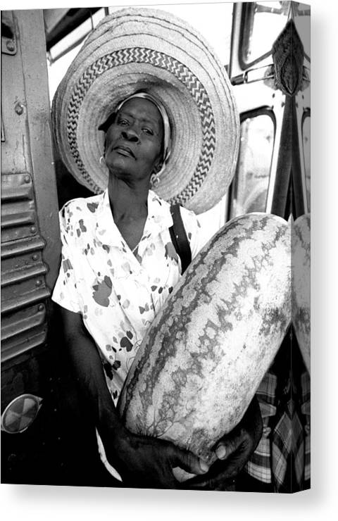 Haitian Migrant Canvas Print featuring the photograph The Winner by Michael L Kimble