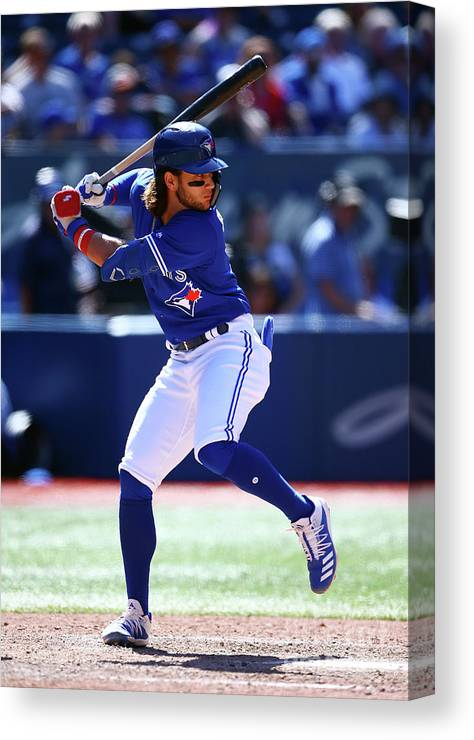 People Canvas Print featuring the photograph Texas Rangers V Toronto Blue Jays by Vaughn Ridley
