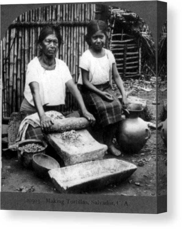 1900s Canvas Print featuring the photograph Grinding Corn For Tortillas by Everett