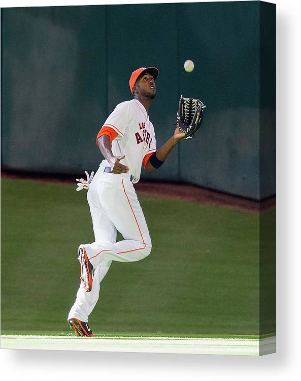 American League Baseball Canvas Print featuring the photograph Cole Gillespie And Dexter Fowler by Bob Levey