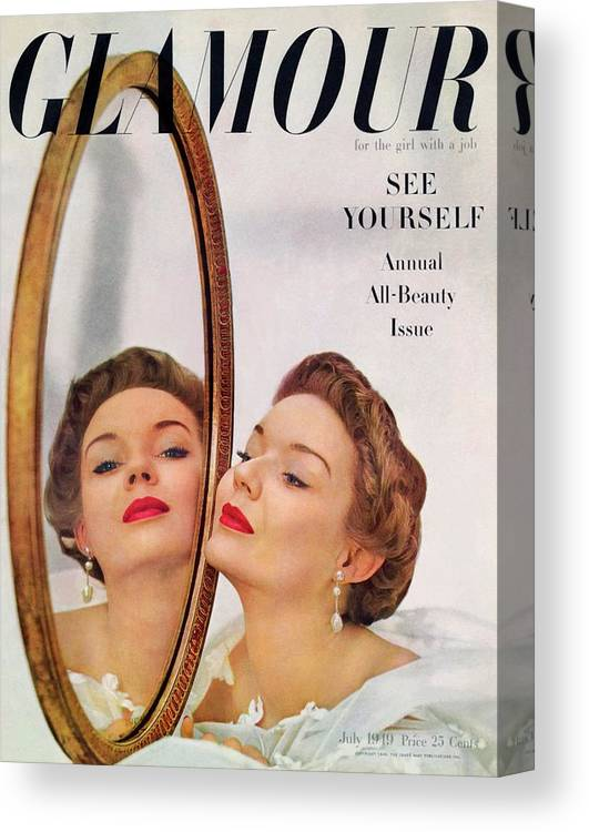 Jewelry Canvas Print featuring the photograph A Model Posing Against A Mirror by John Rawlings
