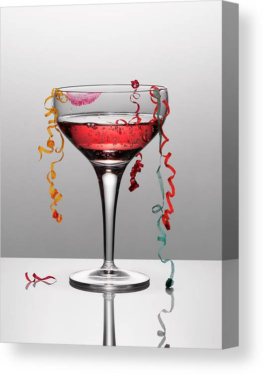 Streamer Canvas Print featuring the photograph Confetti Hanging From Glass Of Pink by Andy Roberts
