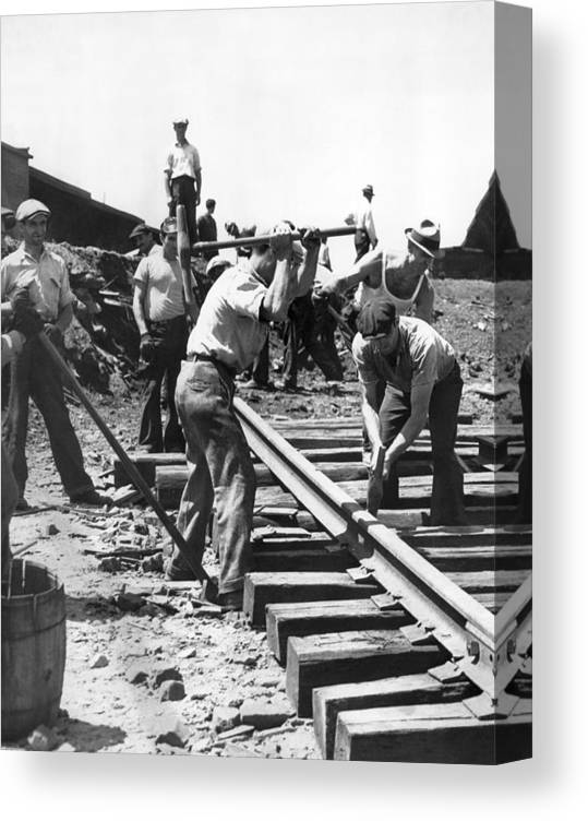 1035-1026 Canvas Print featuring the photograph Men Laying Railroad Track by Underwood Archives
