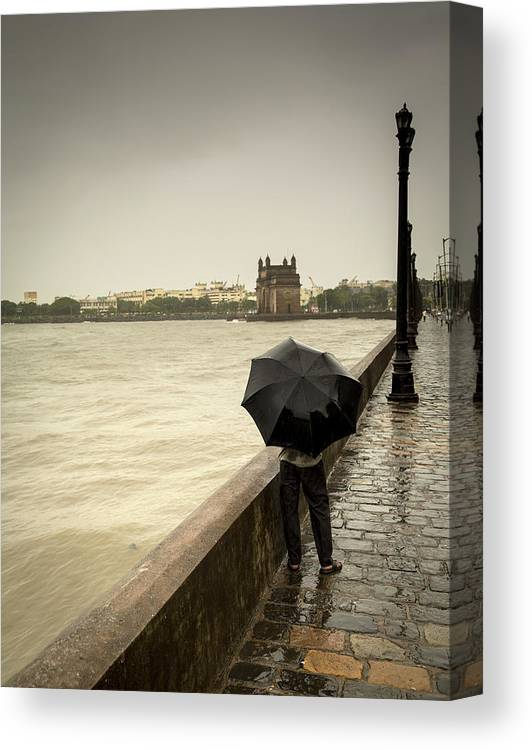 People Canvas Print featuring the photograph Monsoon In Mumbai by Frank Bunnik