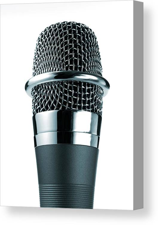 White Background Canvas Print featuring the photograph Studio Shot Of Microphone On White by David Arky