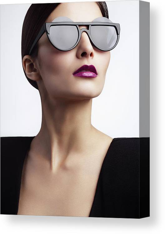 Cool Attitude Canvas Print featuring the photograph Woman With Trendy Eyewear by Lambada