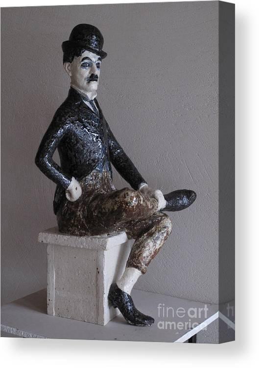 Charlie Chaplin Canvas Print featuring the sculpture Charlie Chaplin by Raimonda Jatkeviciute-Kasparaviciene