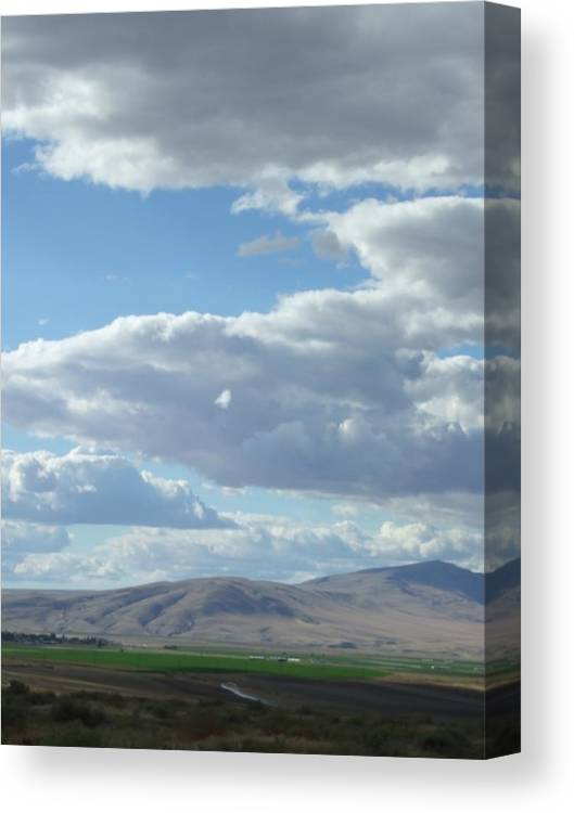 Clouds Canvas Print featuring the photograph Cloudbreaks Over Rattlesnake by Ruth Stromswold