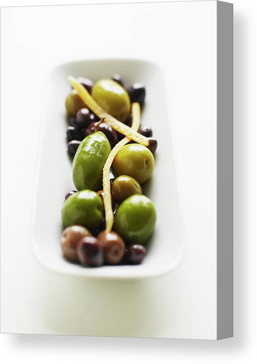 White Background Canvas Print featuring the photograph Appetizer Of Warm Marinated Olives by Thomas Barwick