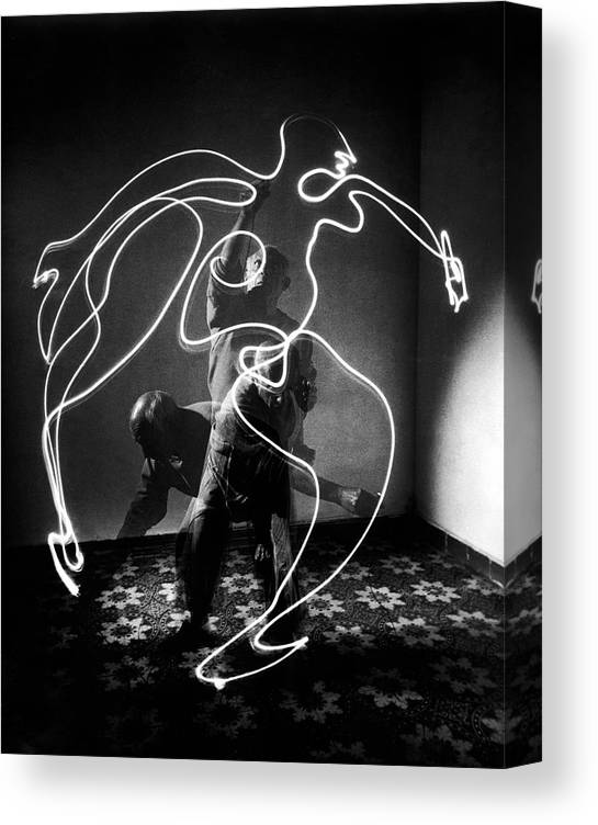 Artist Canvas Print featuring the photograph Artist Pablo Picasso Painting With by Gjon Mili