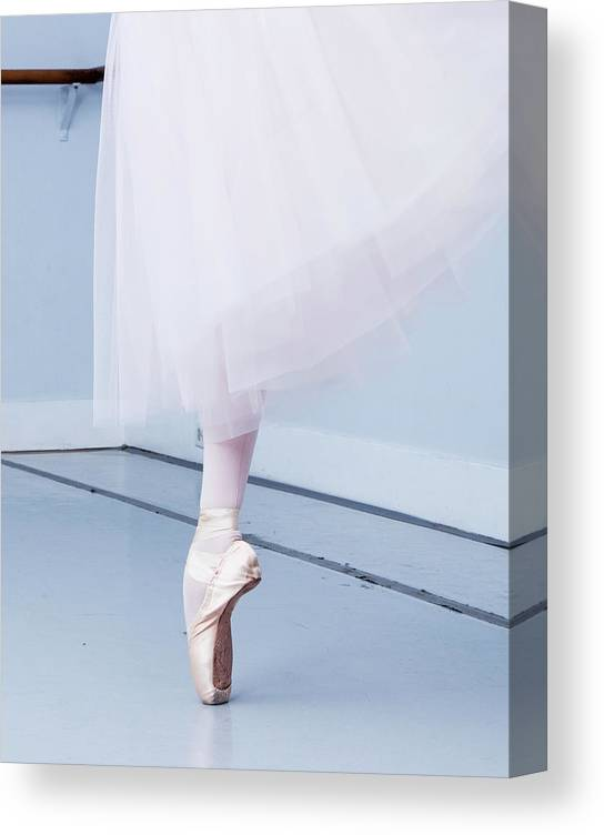 Expertise Canvas Print featuring the photograph Ballerina On Pointe Low Angle View by Jonya