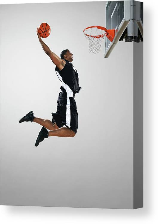 People Canvas Print featuring the photograph Basketball Player Dunking Ball, Low by Blake Little