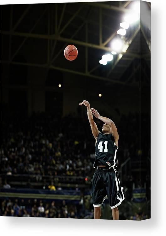 Expertise Canvas Print featuring the photograph Basketball Player Shooting Jump Shot In by Thomas Barwick
