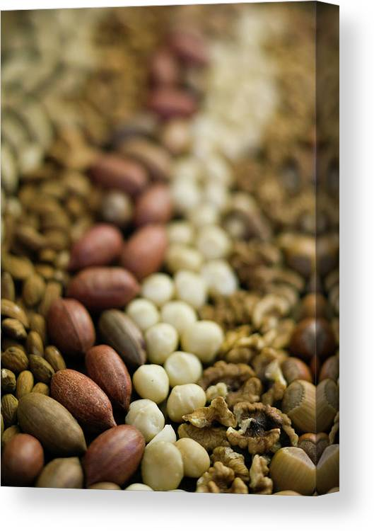 Nut Canvas Print featuring the photograph Close Up Of Variety Of Nuts by Johner Images