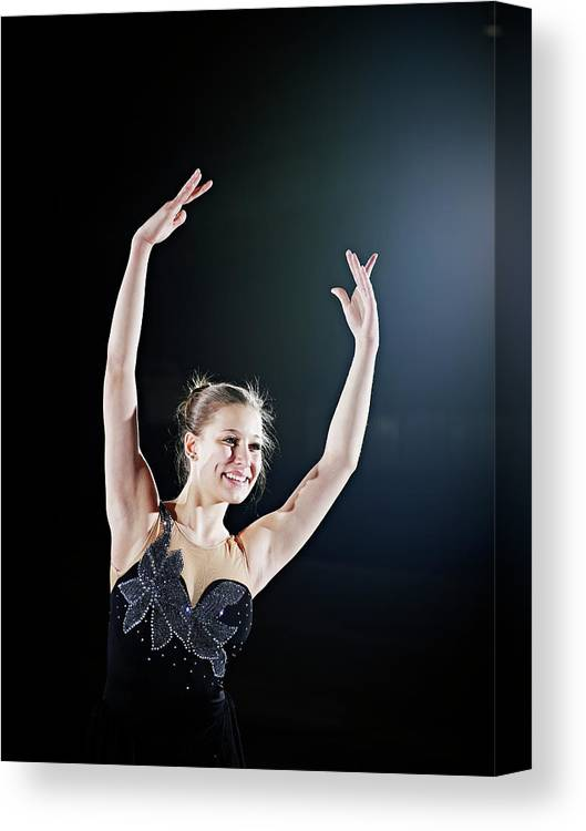 Human Arm Canvas Print featuring the photograph Female Figure Skater Posing With Arms by Thomas Barwick