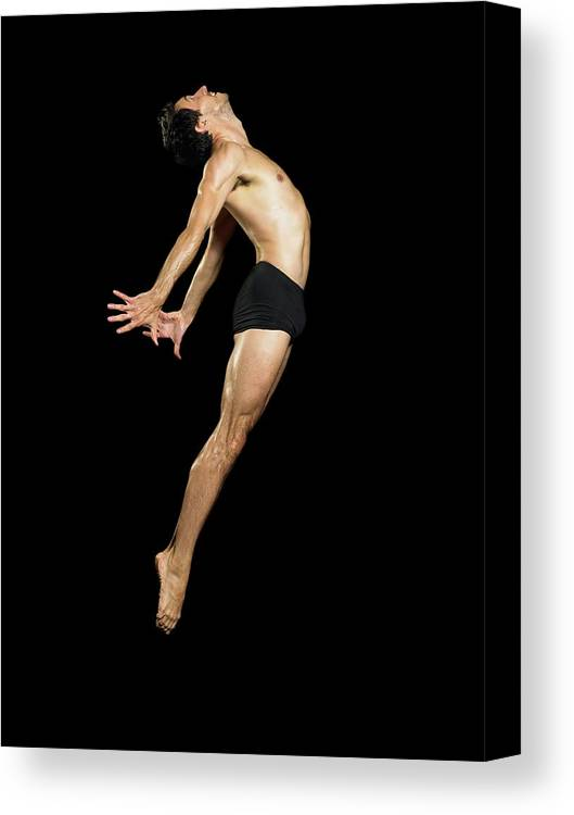 Human Arm Canvas Print featuring the photograph Male Dancer Jumping by Image Source