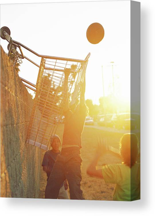 Hanging Canvas Print featuring the photograph Teenage Boys 13-15 Playing Basketball by Sean Murphy