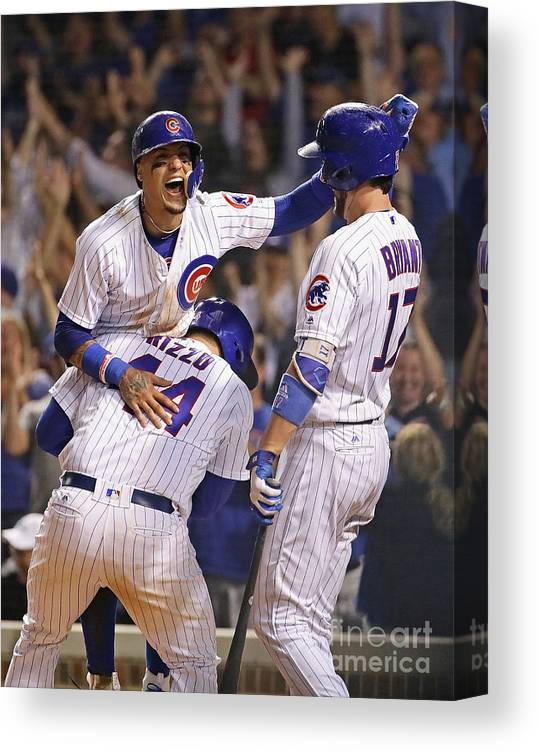 People Canvas Print featuring the photograph Anthony Rizzo, Kris Bryant, and Javier Baez by Jonathan Daniel