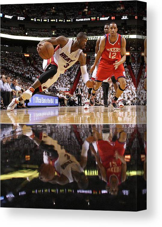 Playoffs Canvas Print featuring the photograph Evan Turner and Dwyane Wade by Mike Ehrmann