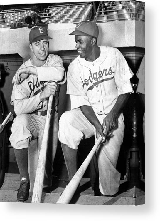 American League Baseball Canvas Print featuring the photograph Jackie Robinson and Pee Wee Reese by New York Daily News Archive