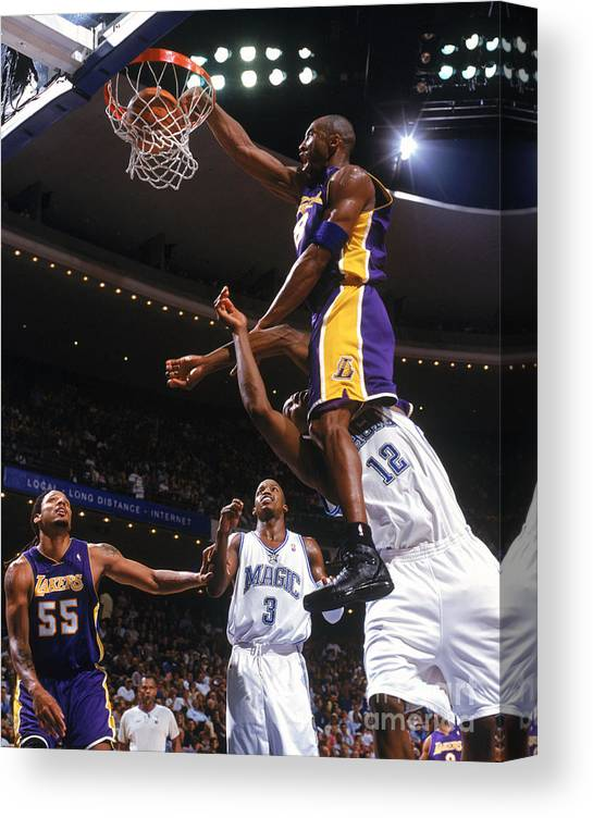 Nba Pro Basketball Canvas Print featuring the photograph Kobe Bryant and Dwight Howard by Fernando Medina