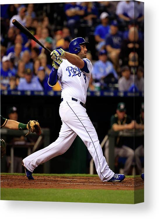 American League Baseball Canvas Print featuring the photograph Mike Moustakas by Jamie Squire