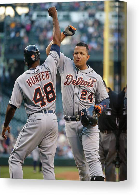 American League Baseball Canvas Print featuring the photograph Torii Hunter and Miguel Cabrera by Otto Greule Jr