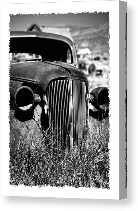 Barren Canvas Print featuring the photograph Classic Car Body In Grassy Field by George Oze