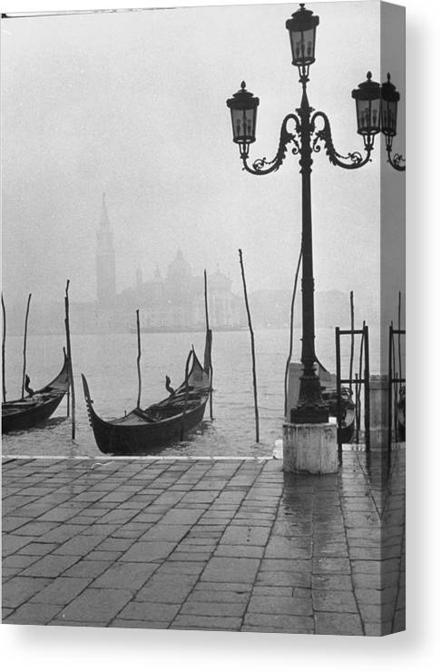 Timeincown Canvas Print featuring the photograph Moored Gondolas On A Foggy Grand Canal W by Dmitri Kessel