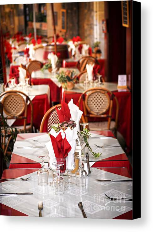 Restaurant Canvas Print featuring the photograph Restaurant Patio In France by Elena Elisseeva