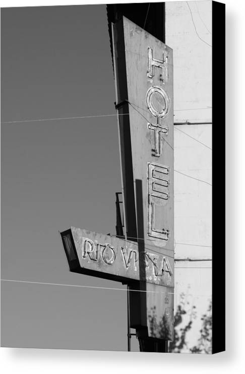 Black And White Canvas Print featuring the photograph Hotel Rio Vista by Troy Montemayor