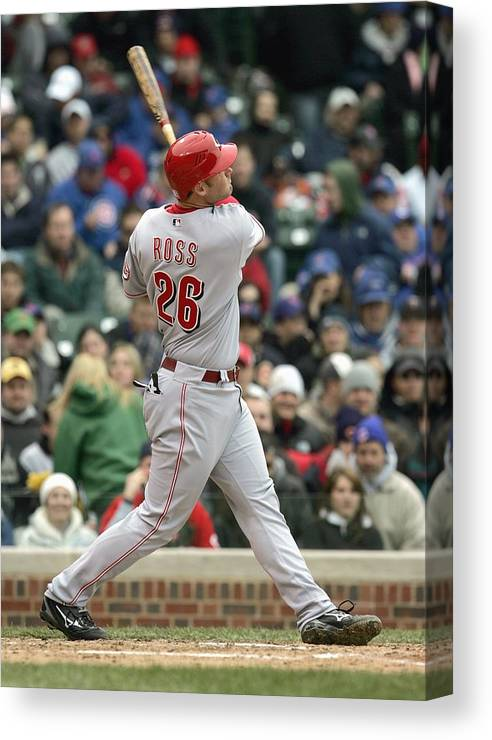 Motion Canvas Print featuring the photograph Cincinnati Reds V Chicago Cubs by Jonathan Daniel