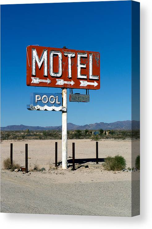 Route 66 Canvas Print featuring the photograph Motel Sign On I-40 And Old Route 66 by Scott Sawyer