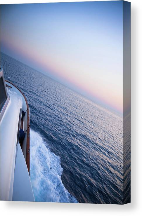 Motorboat Canvas Print featuring the photograph Luxury Motor Yacht Sailing At Sunset by Petreplesea