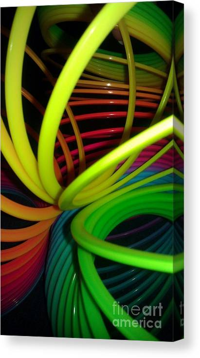 Slinky Canvas Print featuring the photograph Everyone Loves A Slinky by Paulina Roybal