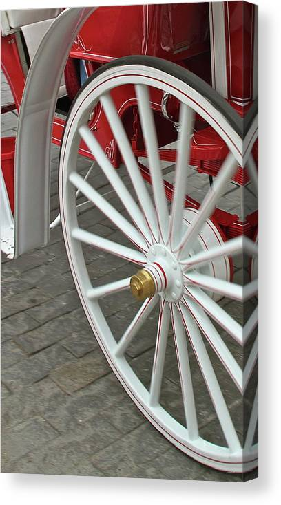 Wheel Canvas Print featuring the photograph Wheel Motion by Rick Monyahan