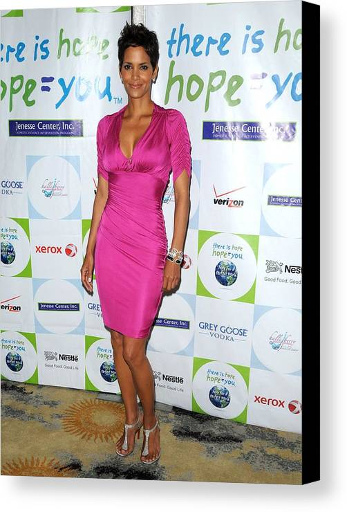 Halle Berry Canvas Print featuring the photograph Halle Berry Wearing A Dress By Roberto by Everett
