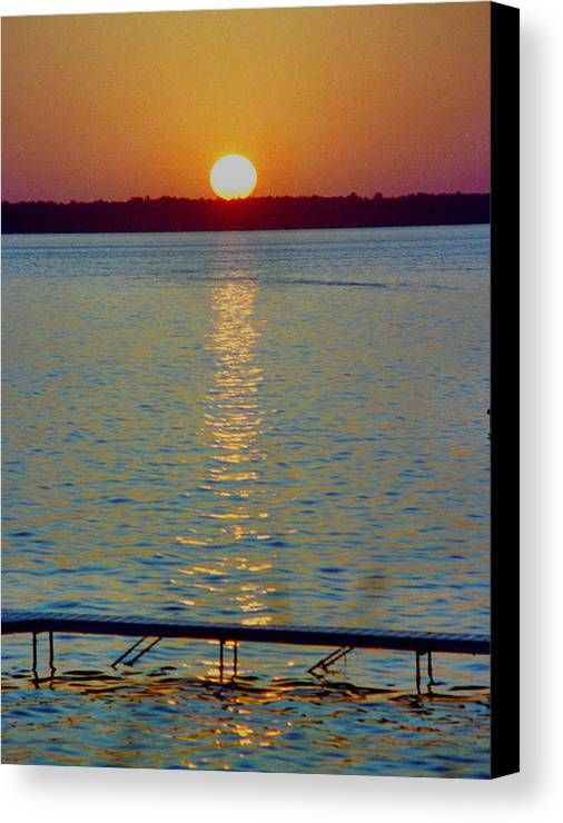 Sunset Canvas Print featuring the photograph Quite Pier Sunset by Randy Oberg