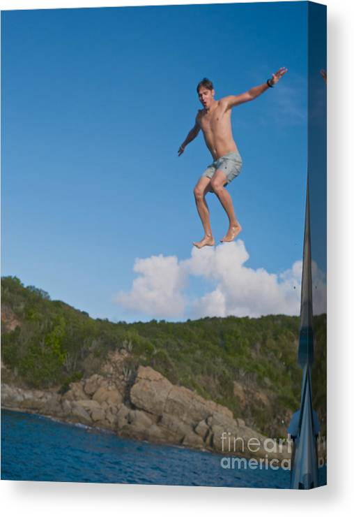 Action Canvas Print featuring the photograph Cloud Surfer by Art By Christiane