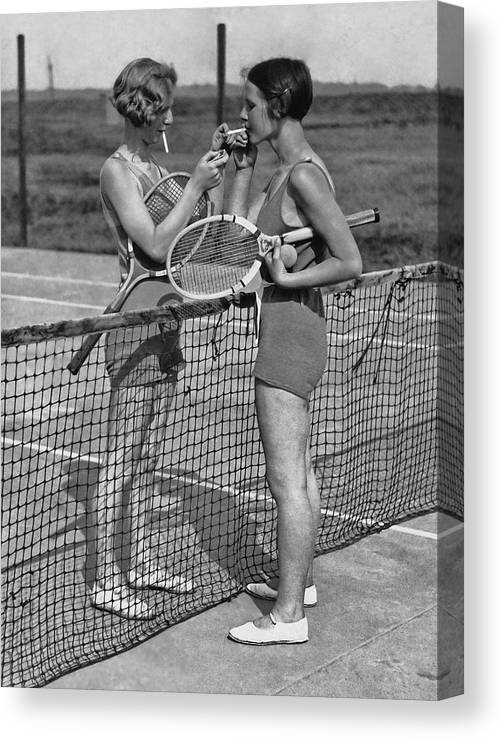 Shadow Canvas Print featuring the photograph Lighting Up After A Tennis Match by Fpg
